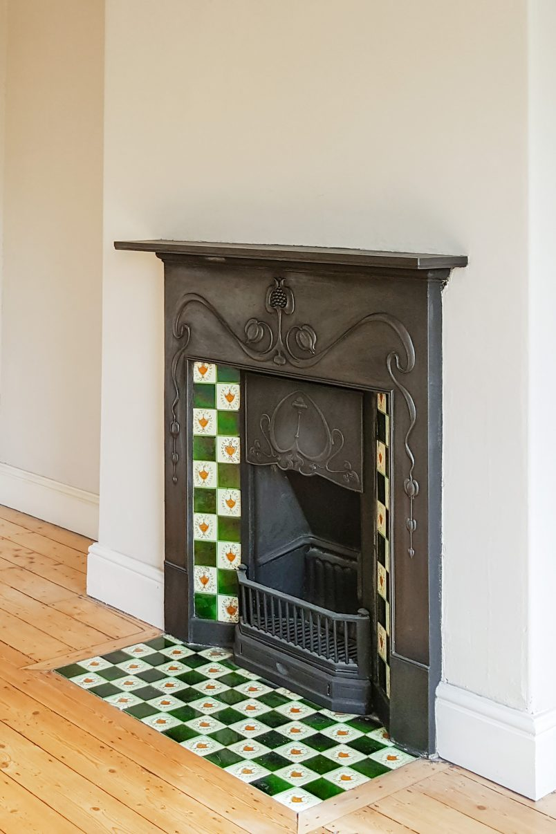 Edwardian Fireplace with green and yellow tiles