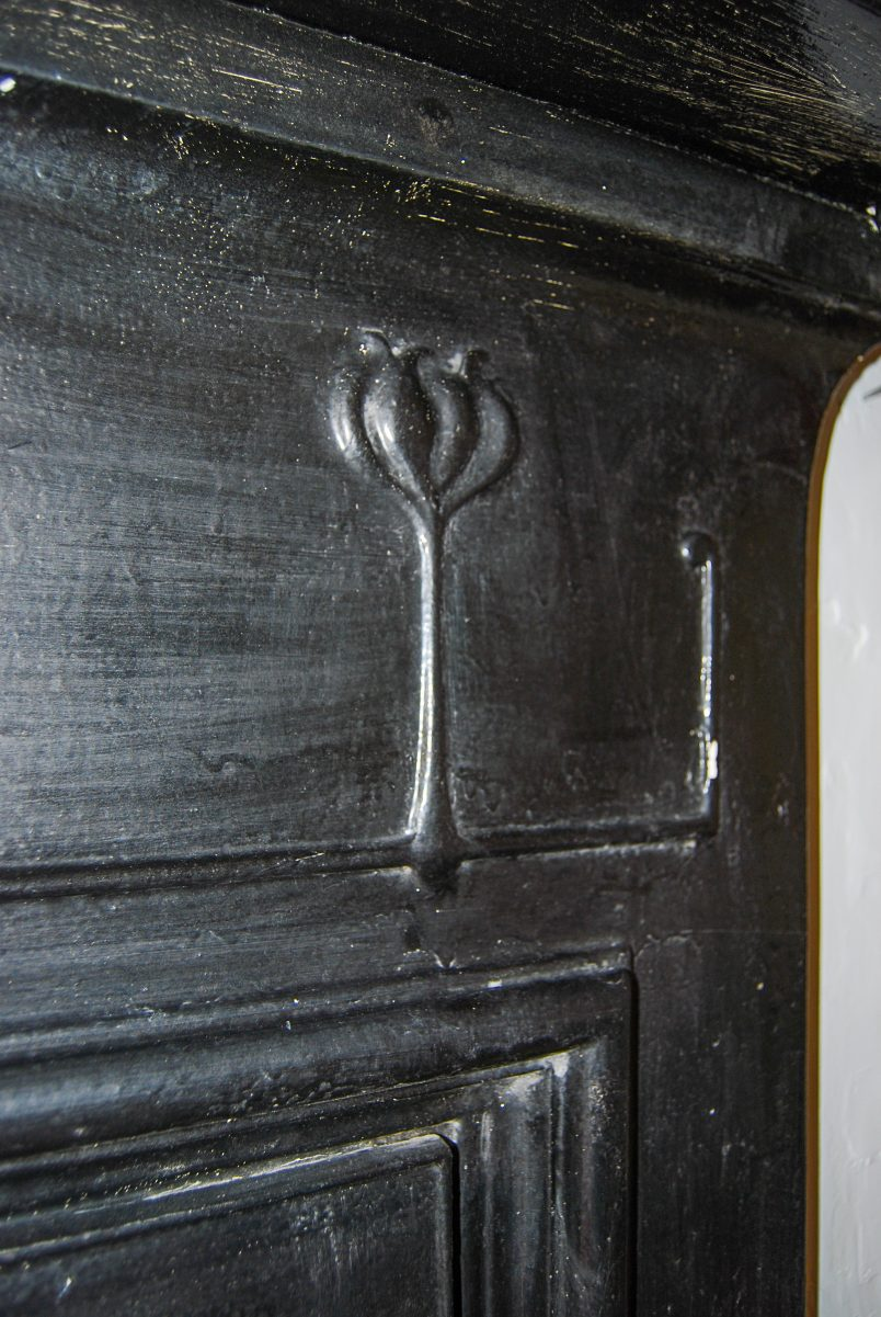 Detail of cast iron fireplace before restoration