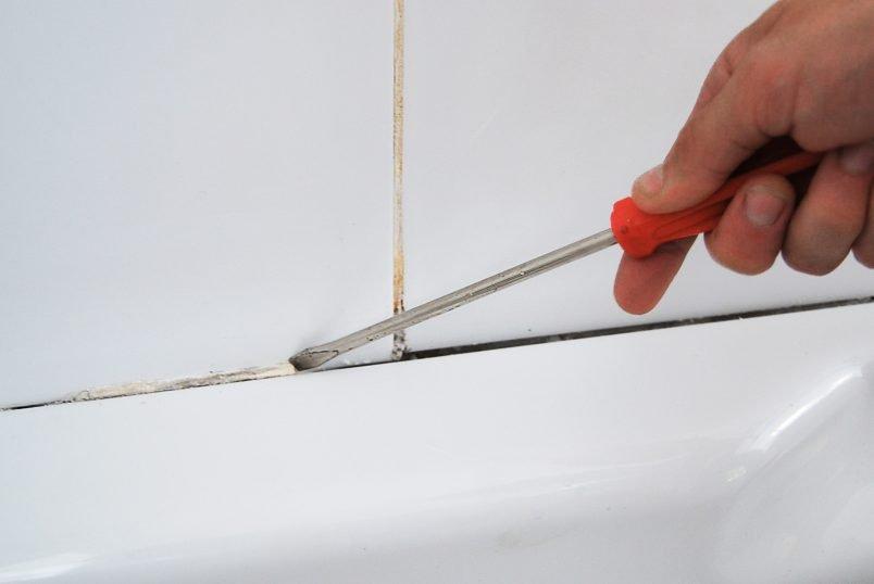 Removing old silicone around bath