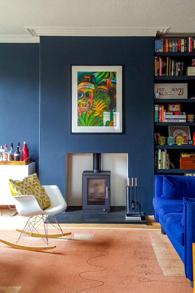 Wood Burner and Dark Blue Walls In Edwardian House