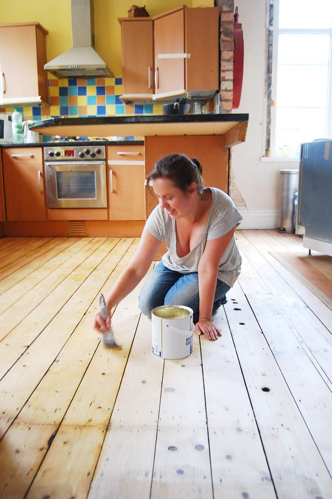 Sanding and varnishing floorboards