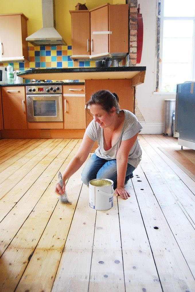 Sanding and varnishing floorboards