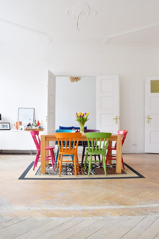 Dining Room with colourful chairs - Little House On The Corner