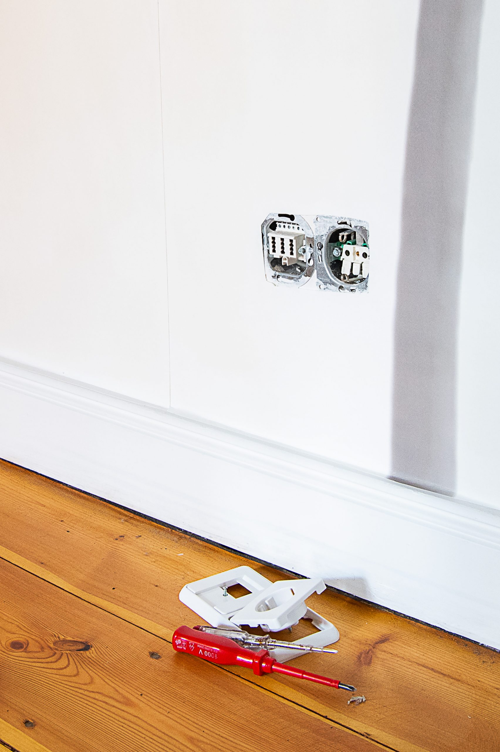 Wallpapering around a socket | Little House On The Corner