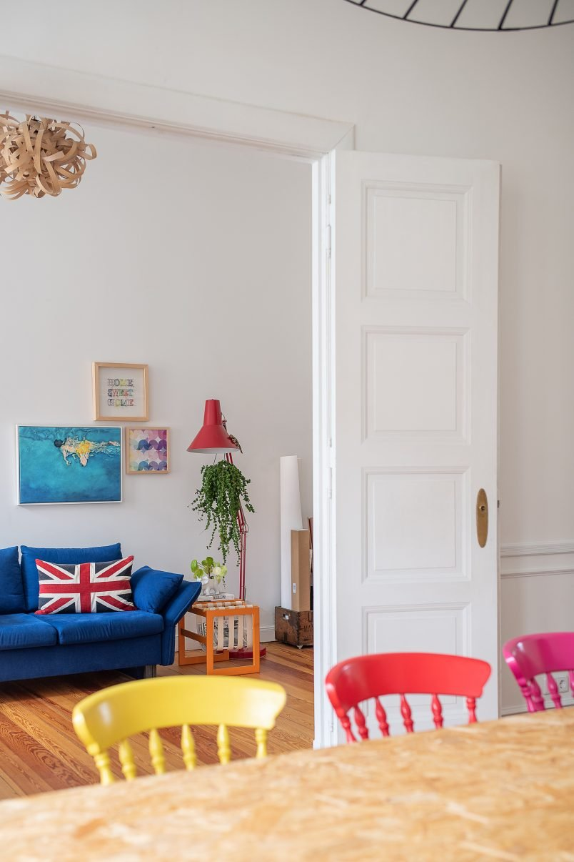 View Into Study with dark blue sofa and double doors   Little House On The Corner