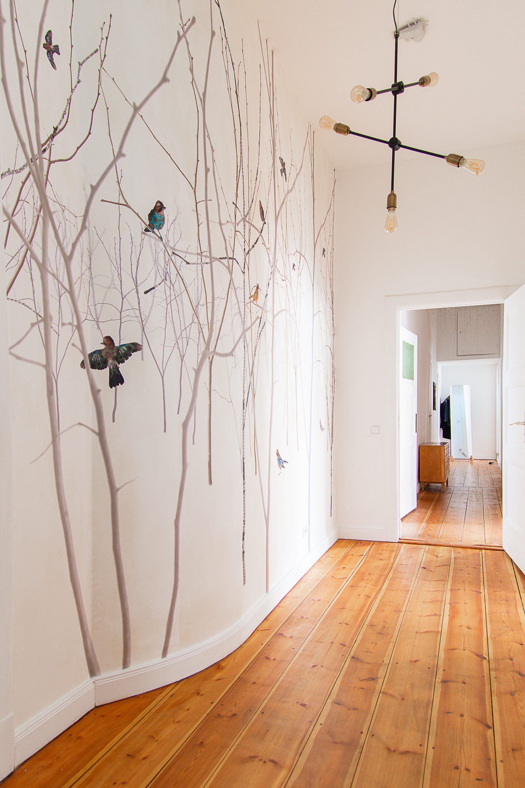 Hallway with curved wall and Photowall Pattern Jay Mural | House Doctor Molecular Lamp and Exposed Floorboards | Little House On The Corner