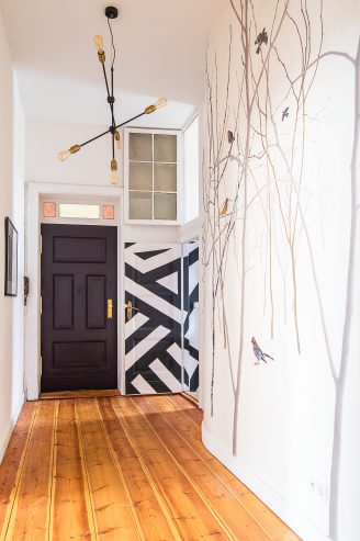 Hallway with Pattern Jay Photowall, exposed floorboards and Paean Black front door | Little House On The Corner