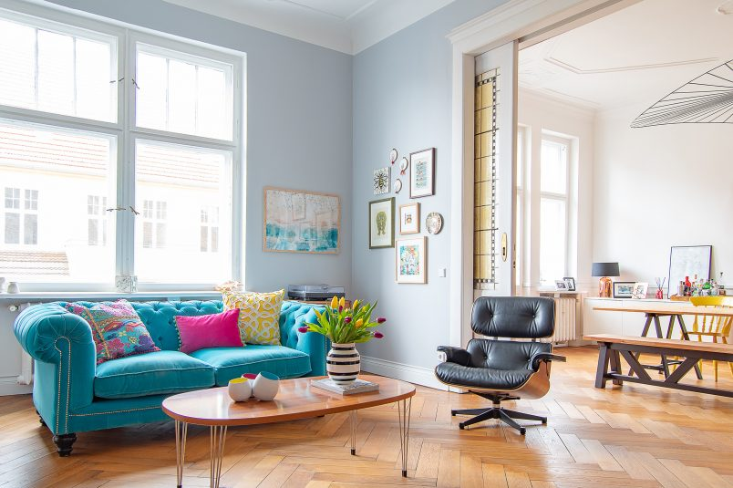 Living Room with turquoise Chesterfield Sofa and Eames Lounge Chair