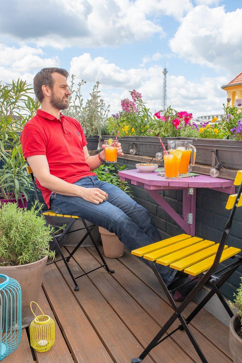 enjoying cocktail on balcony
