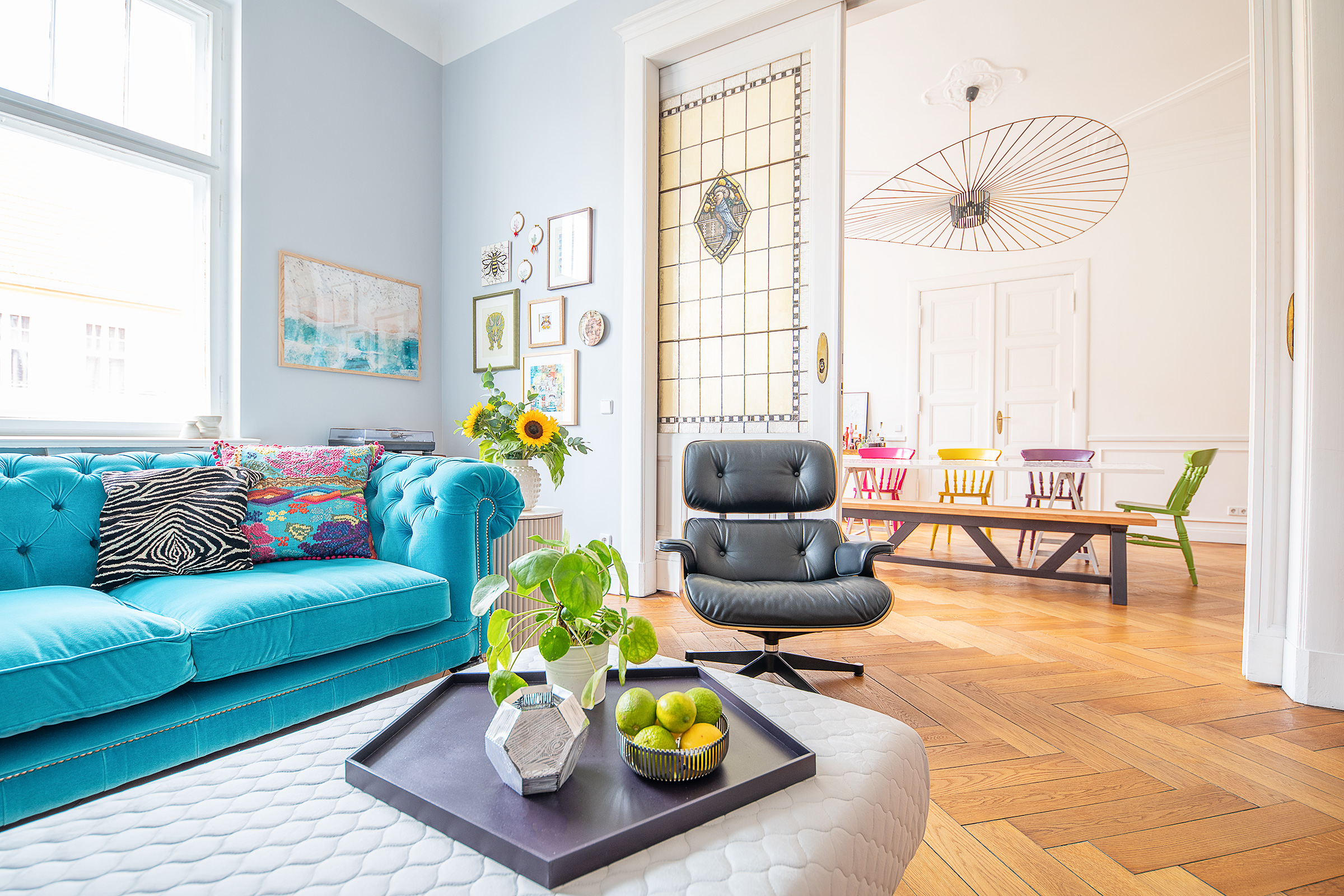 Living Room With Turquoise Chesterfield, Ottoman and Ribbed Sidetable