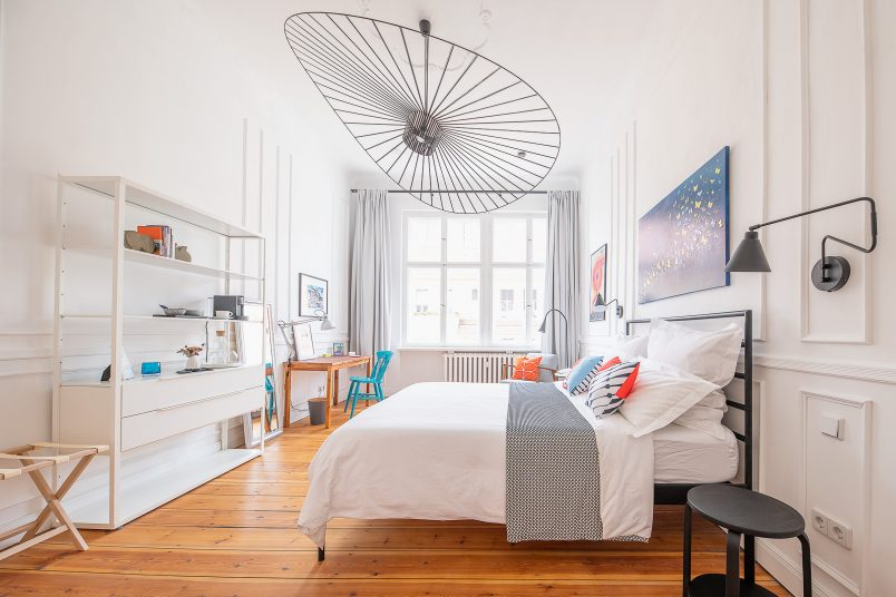 Bedroom with white walls and bedding