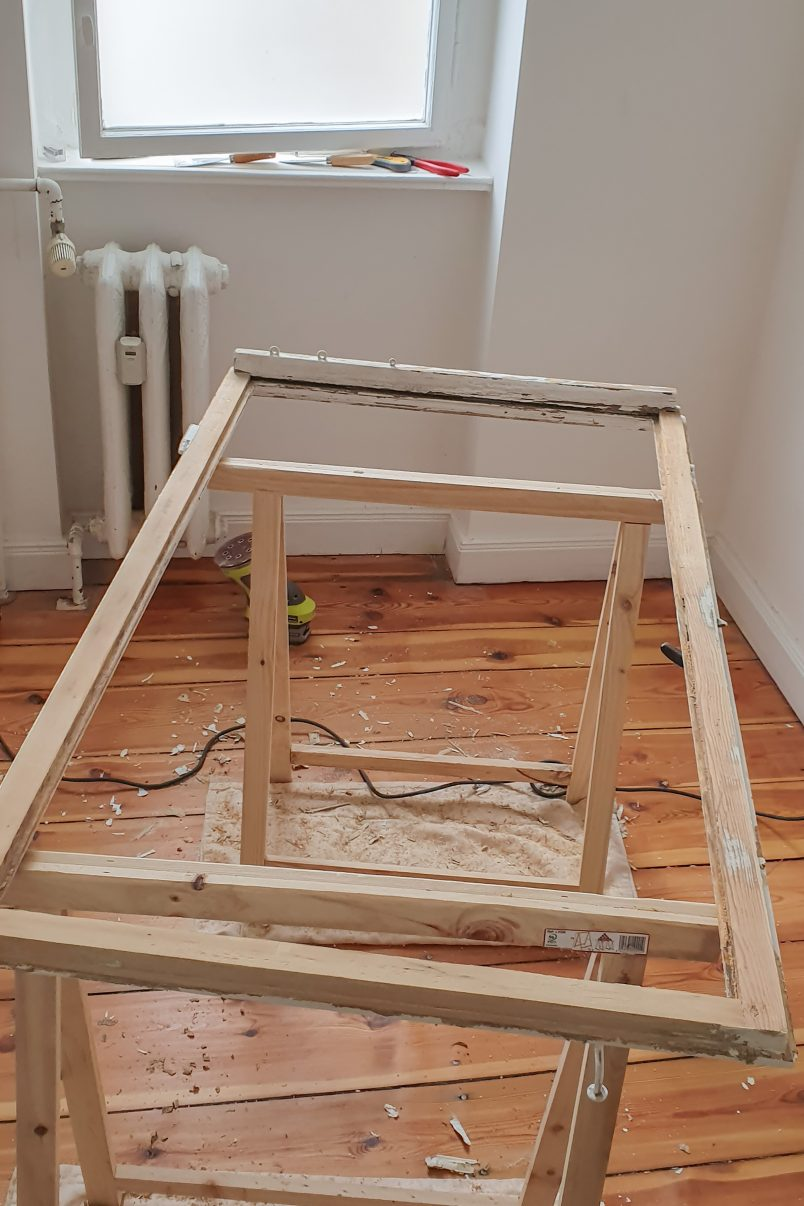 bare timber window frame without glass