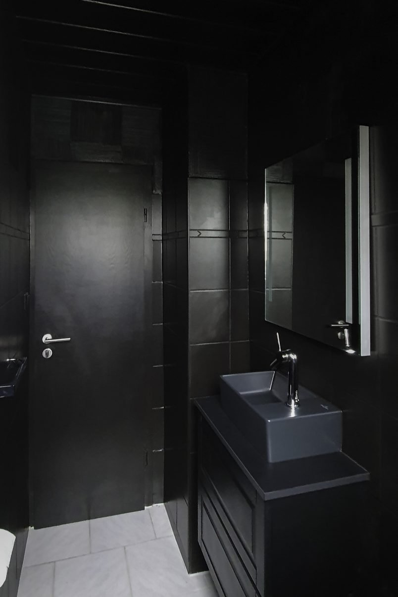 Black Guest Bathroom with painted tiles