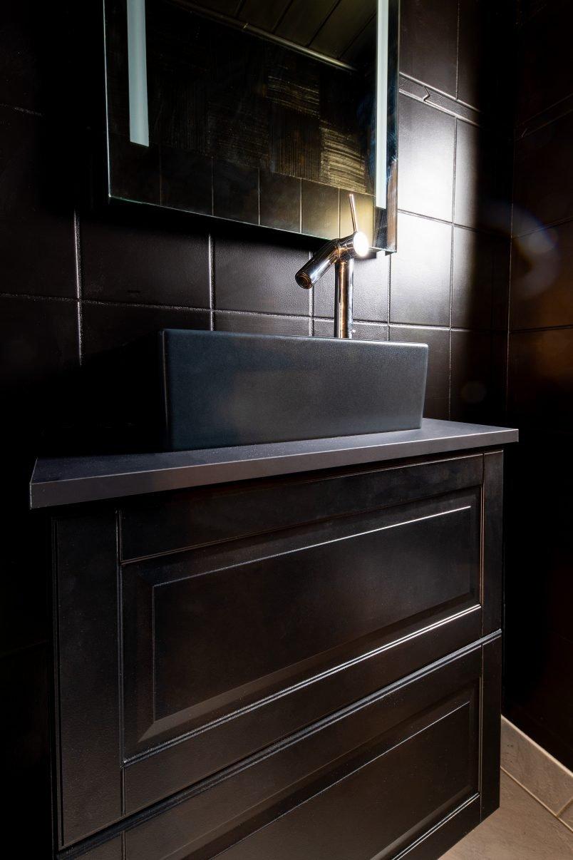 Painted tiles in all black bathroom