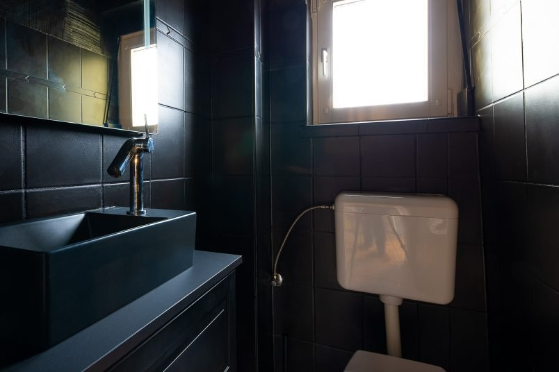 All Black Bathroom with painted tiles