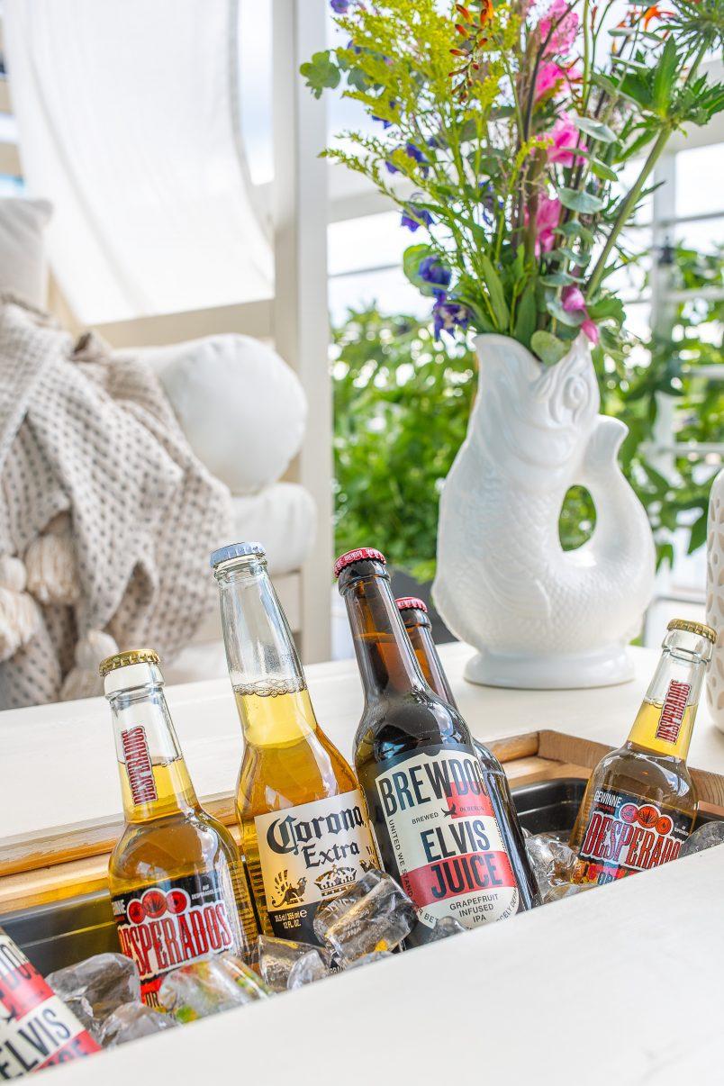 DIY outdoor coffee table with hidden drinks cooler.