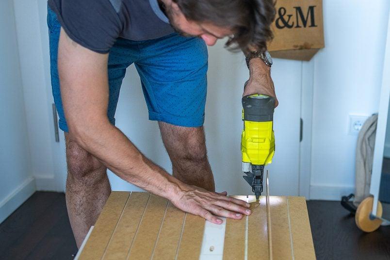 nailing cladding to IKEA Pax wardrobe - Copy