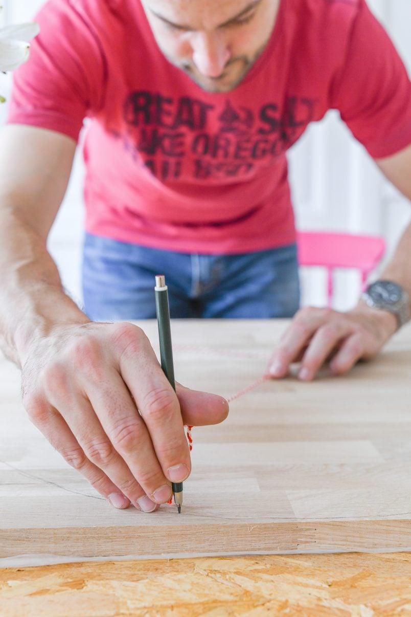 Drawing a large circle with string and nail