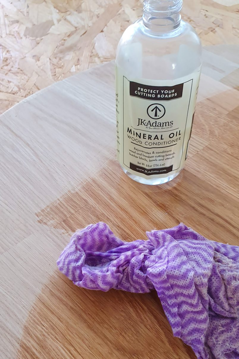 Oiling wooden serving board