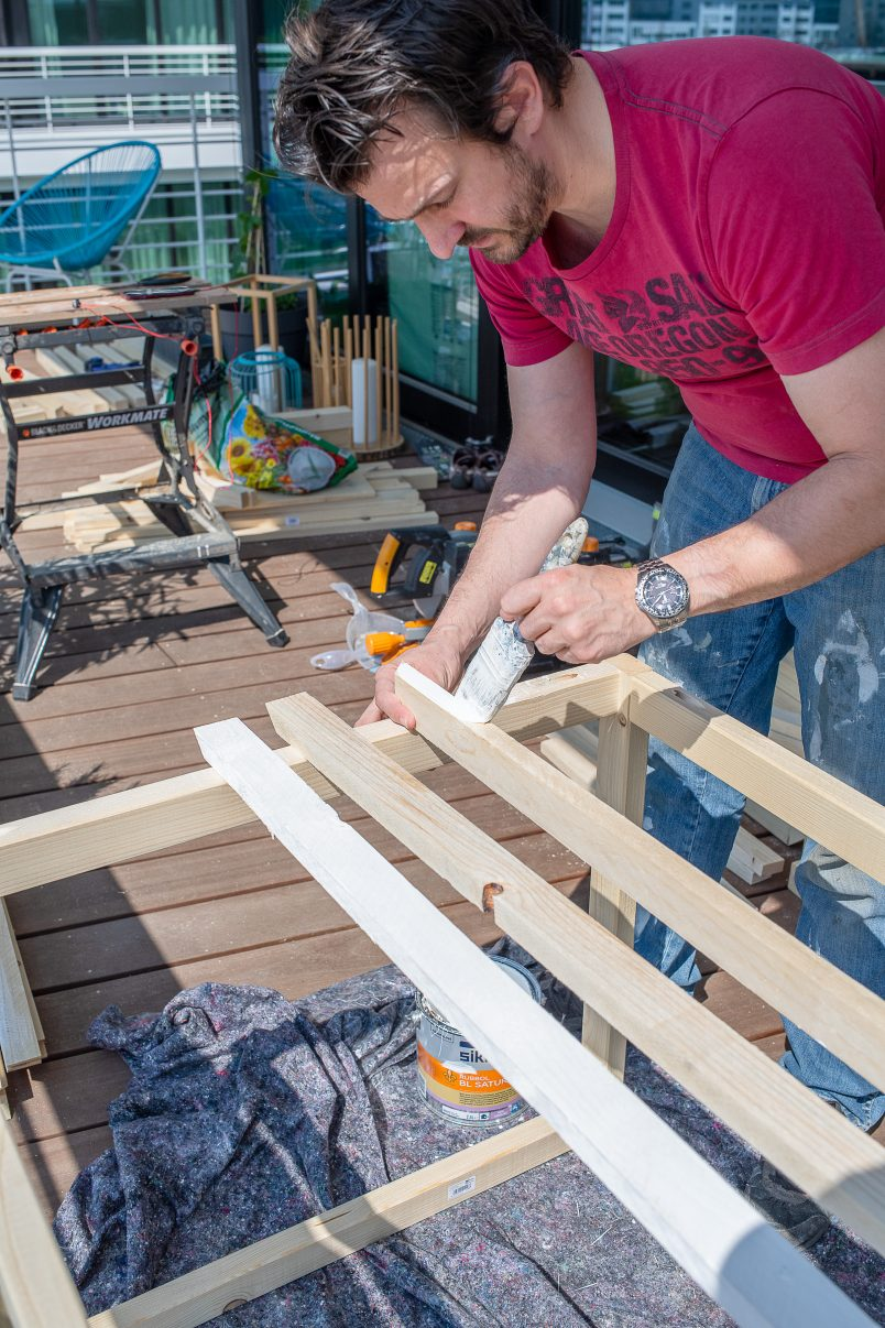 Painting slats for DIY outdoor storage box