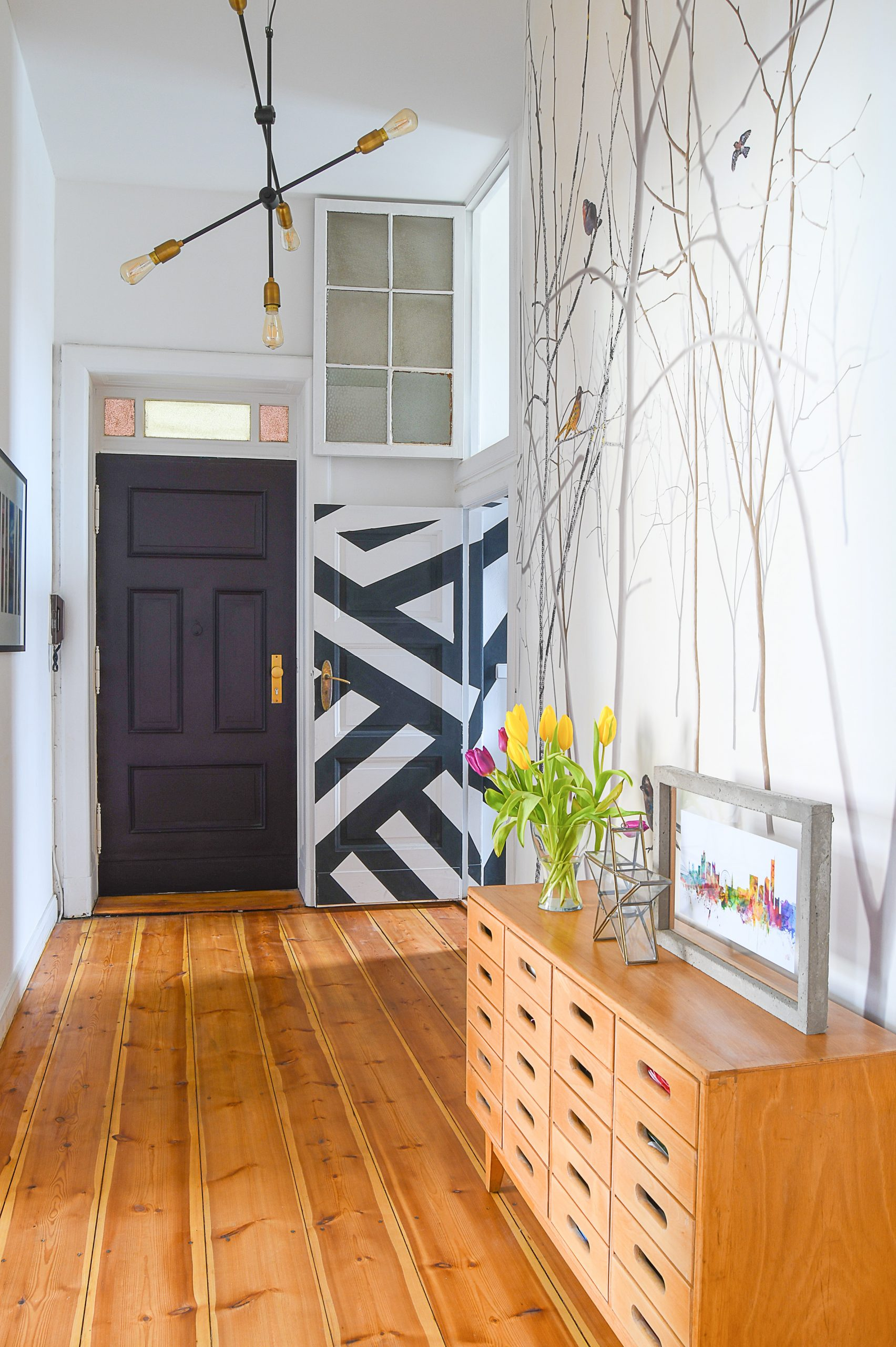 Hallway with Paean Black Front Door After Editing With Interior Presets for Lightroom by Little House On The Corner